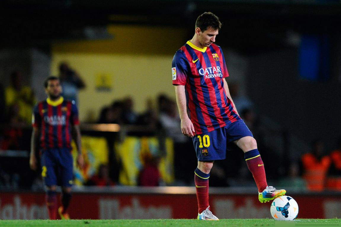 Lionel Messi waiting to resume the game in t he midfield line