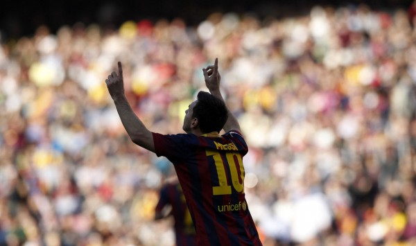 Messi sticking his two fingers in the air