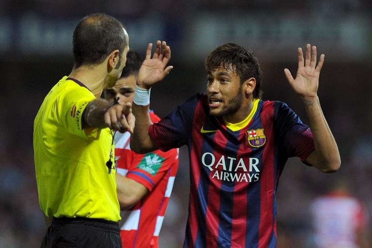 Neymar claiming innocence to the referee