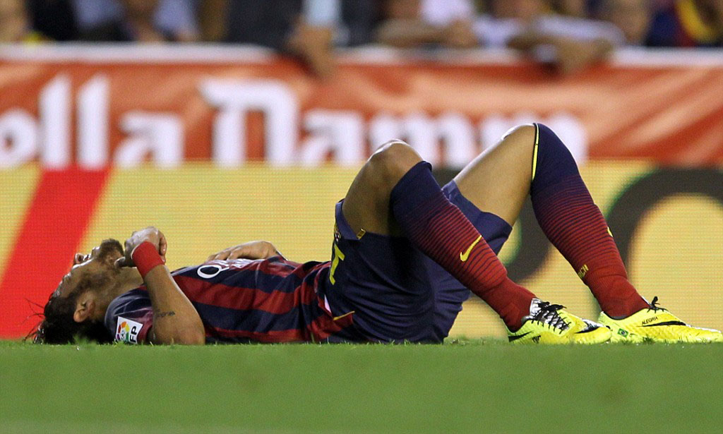 Neymar layed down on the grass