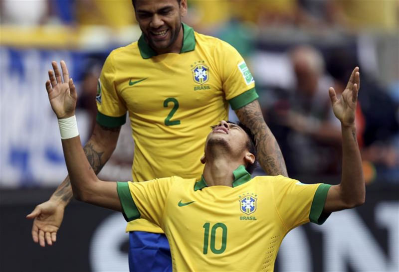Daniel Alves and Neymar celebrating a goal for Brazil