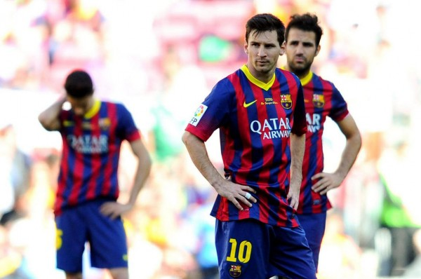 Lionel Messi and Fabregas looking disappointed in Barcelona