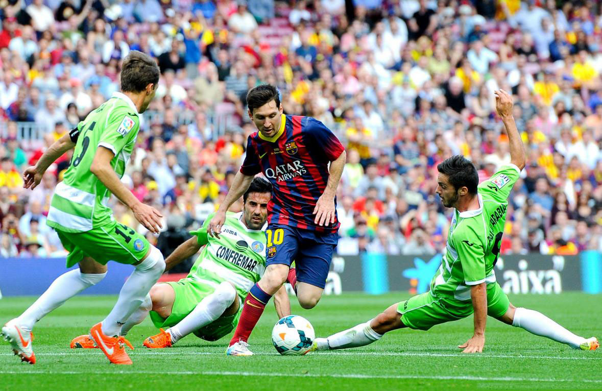 Lionel Messi dribbling several defenders like Maradona