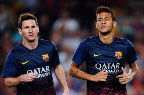 Lionel Messi running next to Neymar, in FC Barcelona training