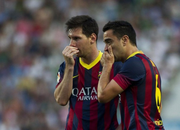 Messi and Xavi in a FC Barcelona match