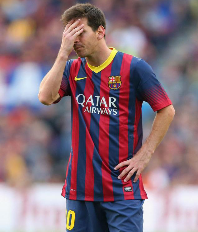 Messi covering his face in shame