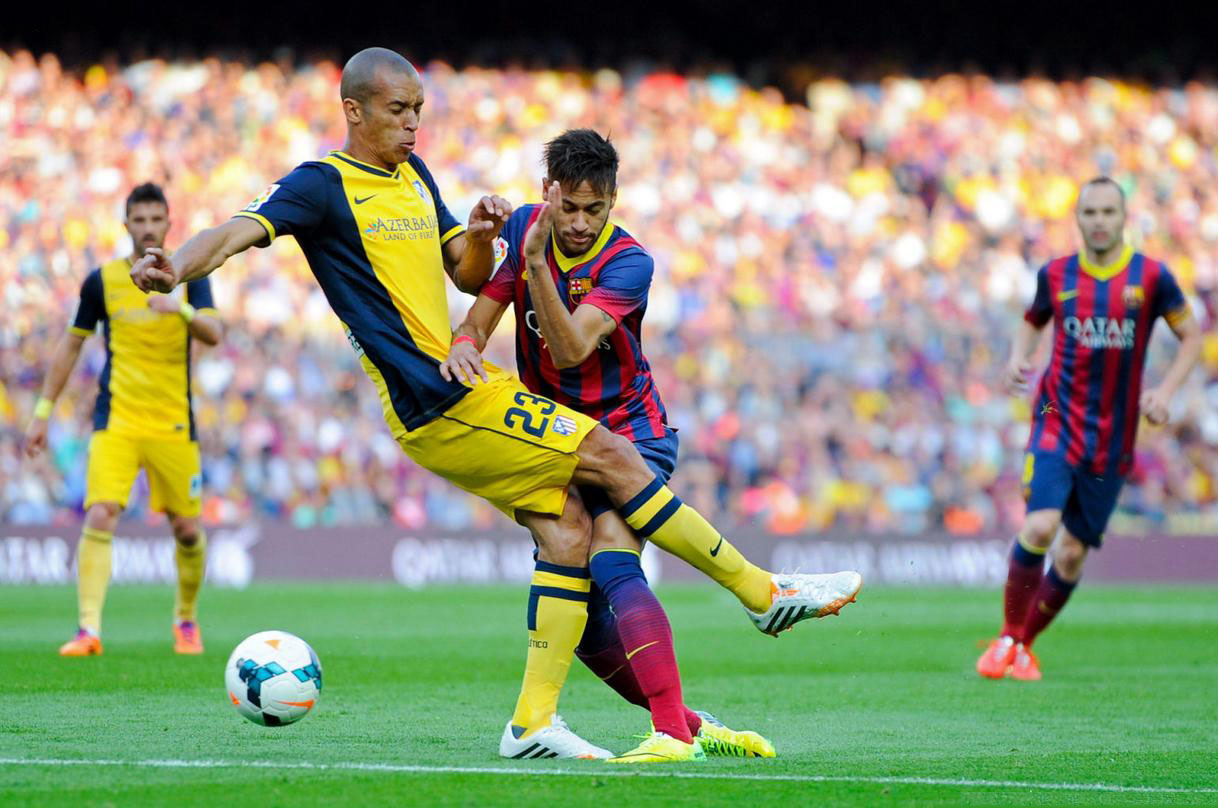 Miranda tackling Neymar, in Barcelona vs Atletico