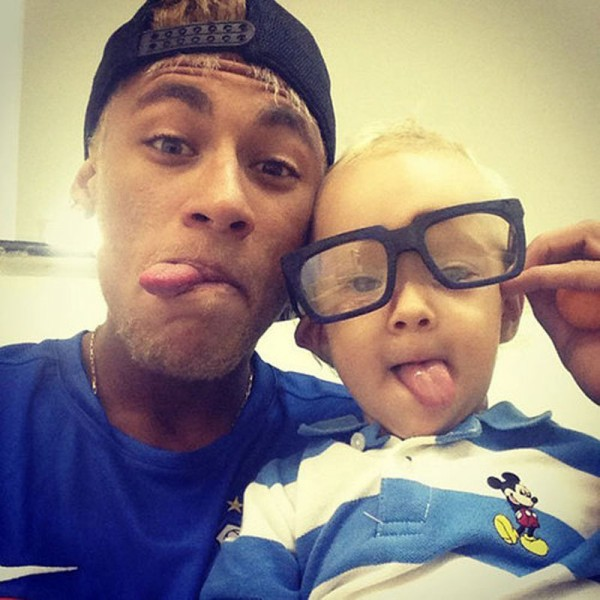 Neymar and his son David Lucca, wearing eye glasses