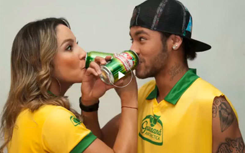 Neymar in a Brazil World Cup Guarana campaign photo, with a Brazilian model