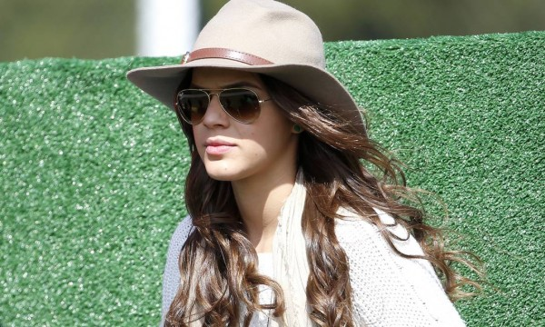 Bruna Marquezine watching the Brazilian National Team training session wearing a cowboy hat