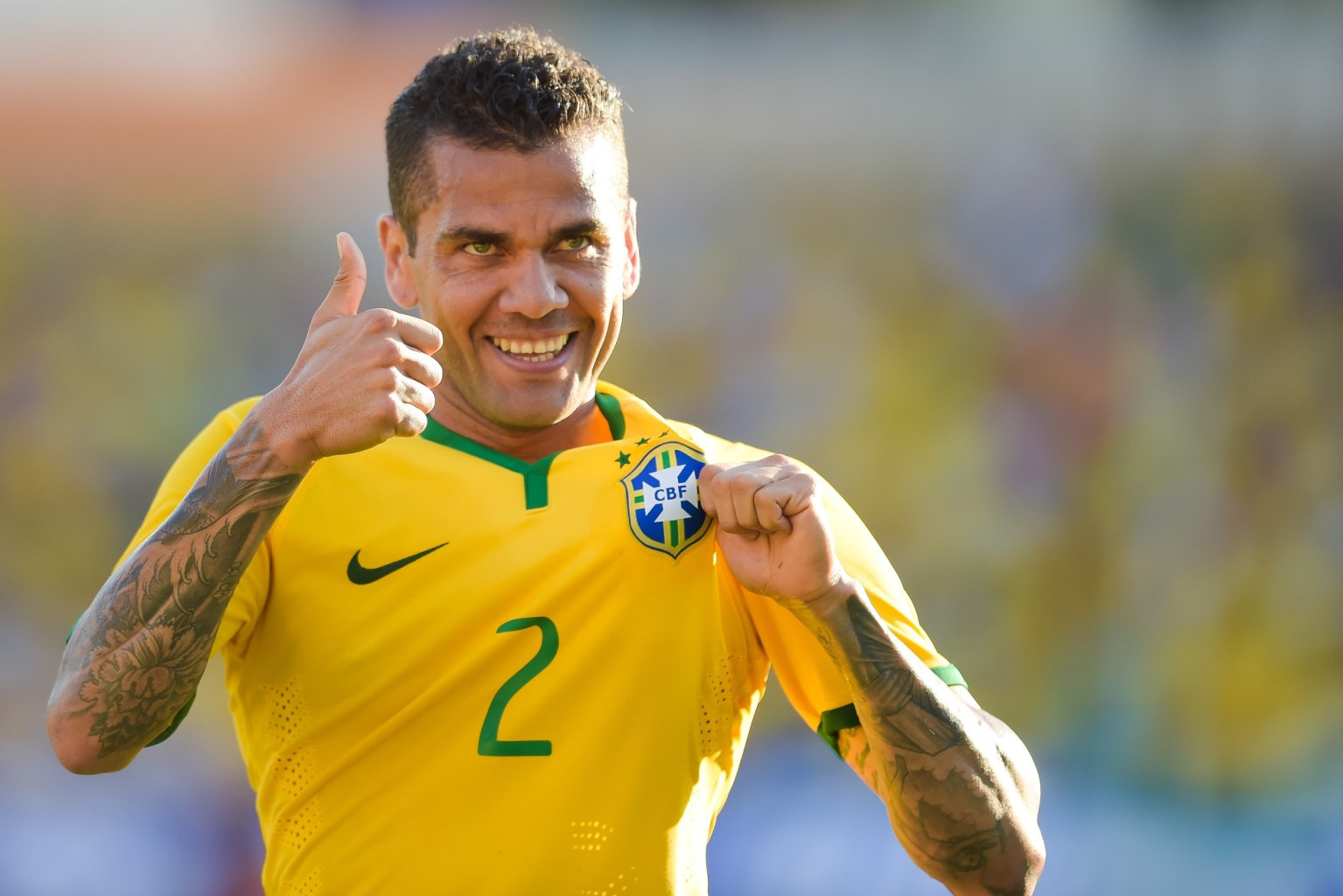 Daniel Alves holding the Brazil badge