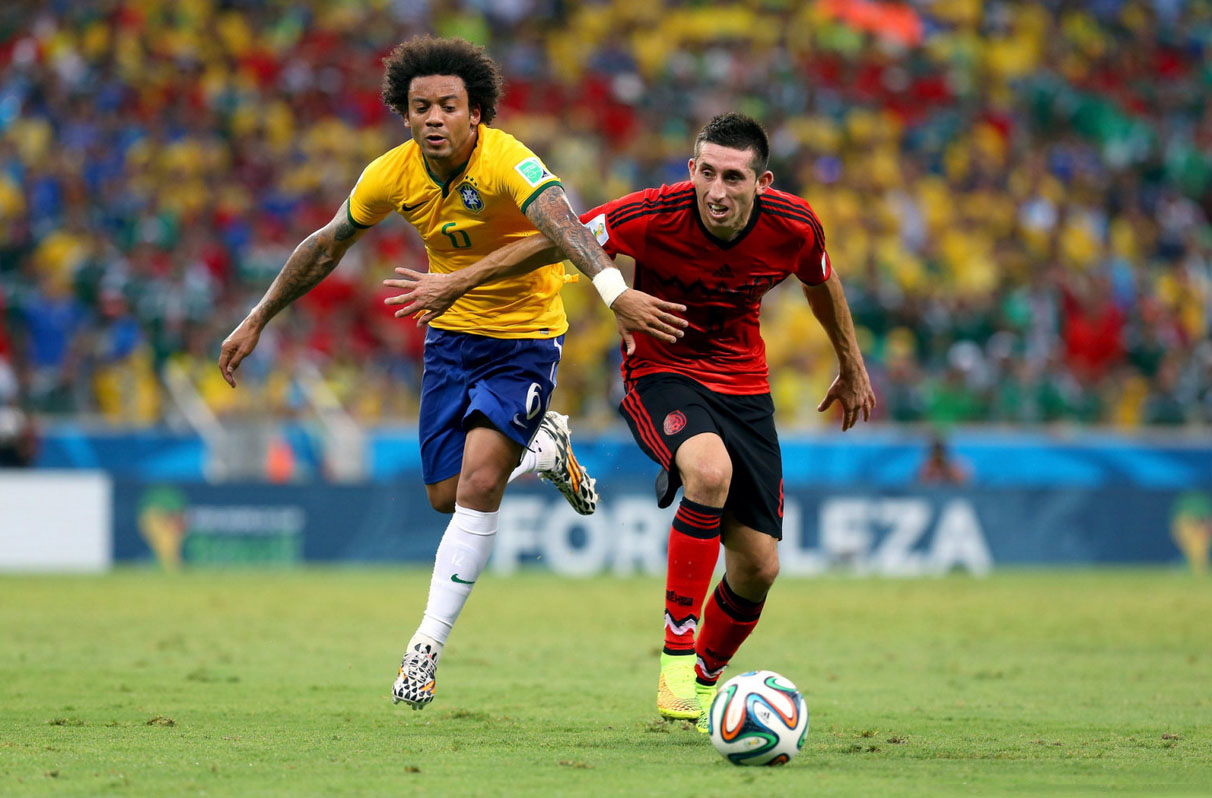 Marcelo and Herrera in Brazil vs Mexico in the FIFA World Cup 2014