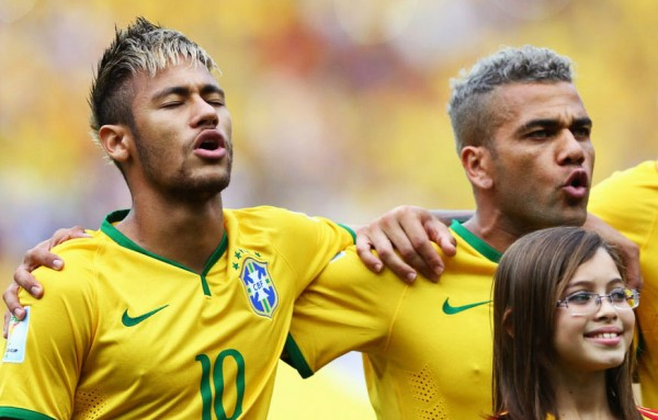 Neymar and Daniel Alves singing Brazil's National Anthem with a new hairstyle and visual for the FIFA World Cup 2014