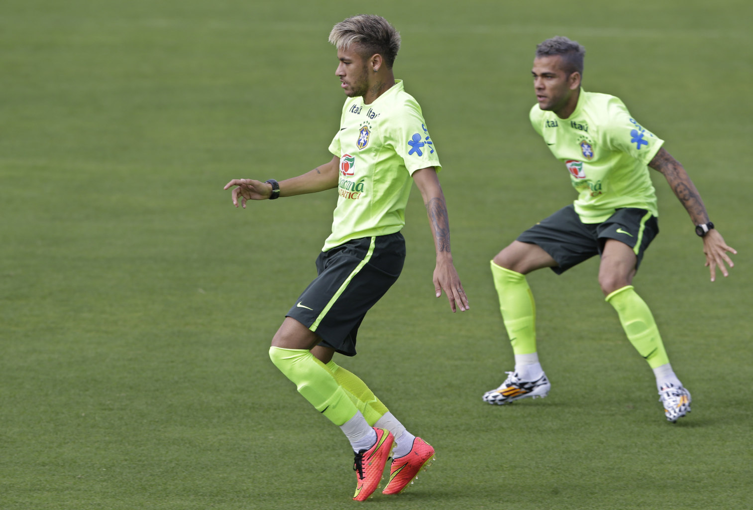 Neymar and Daniel Alves new look, in Brazil's training session in World Cup 2014