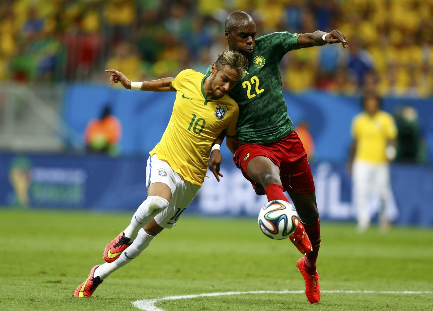 Neymar body strength and balance in Brazil's FIFA World Cup 2014