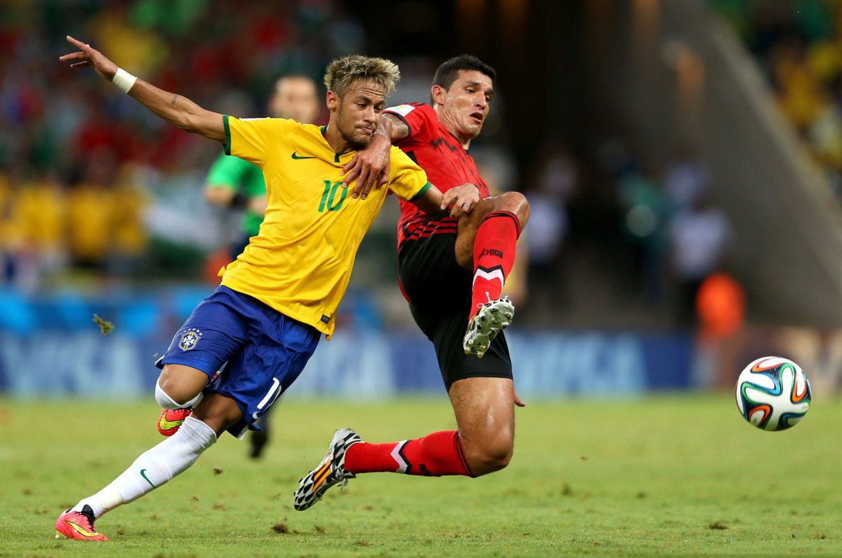 Neymar challenging for a loose ball, in Brazil 0-0 Mexico, at the FIFA World Cup 2014