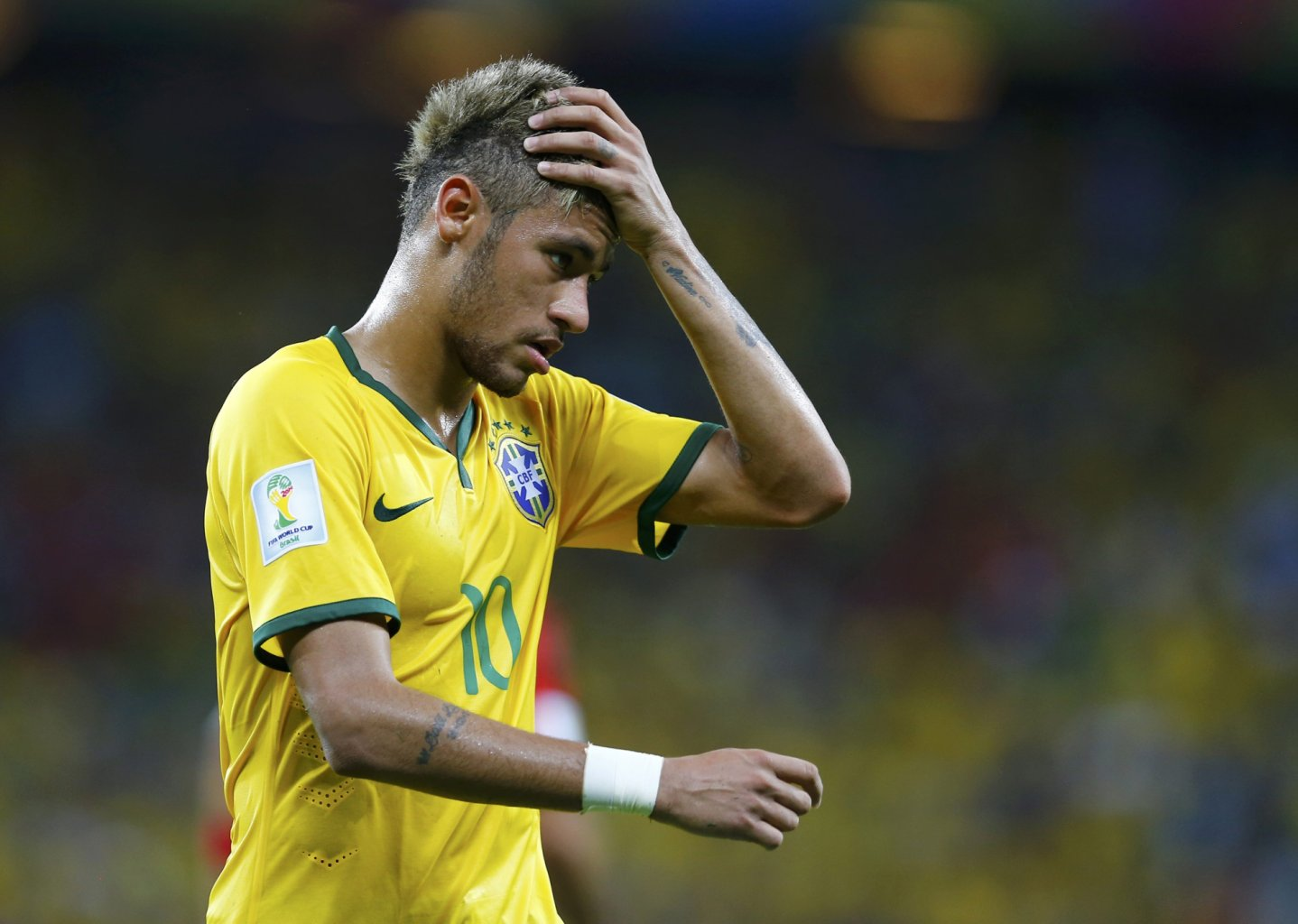 Neymar combing his new hair at the FIFA World Cup 2014