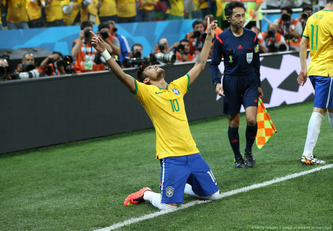 Neymar gets down on his knees to celebrate a goal in Brazil vs Croatia