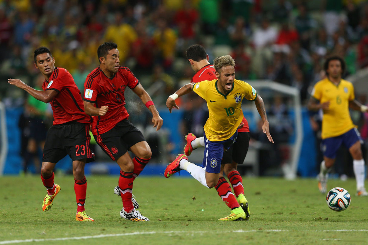 Neymar getting fouled in Brazil vs Mexico in the FIFA World Cup 2014