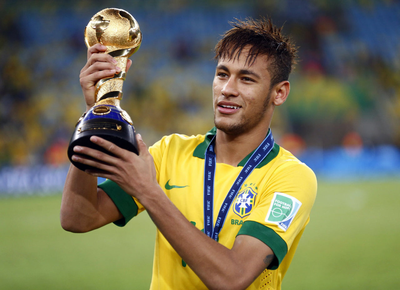 Neymar holding a small World Cup trophy