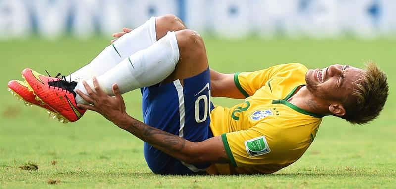 Neymar injured during a game at the FIFA World Cup 2014
