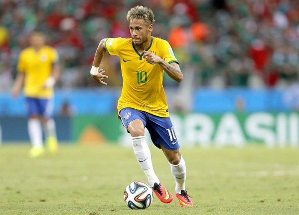 Neymar racing with the ball glued to his foot, in the FIFA World Cup 2014
