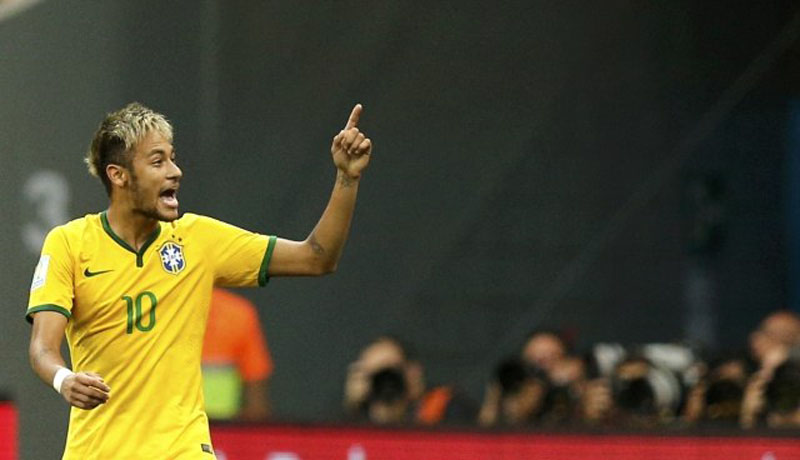 Neymar raising his finger to the air, in a Brazil match