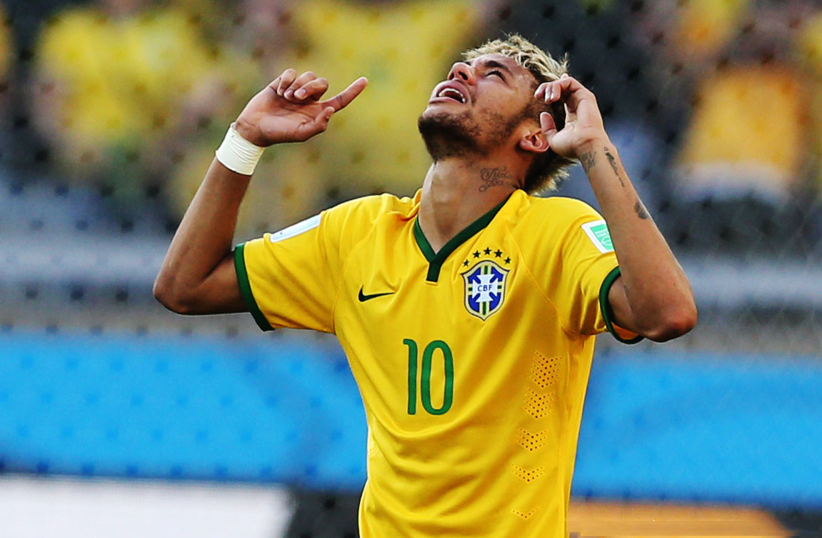 Neymar raising his two fingers to the sky