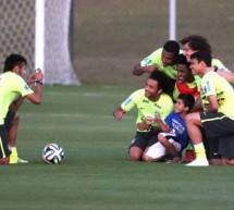 Neymar helps a pitch invader kid meeting the Brazilian Team