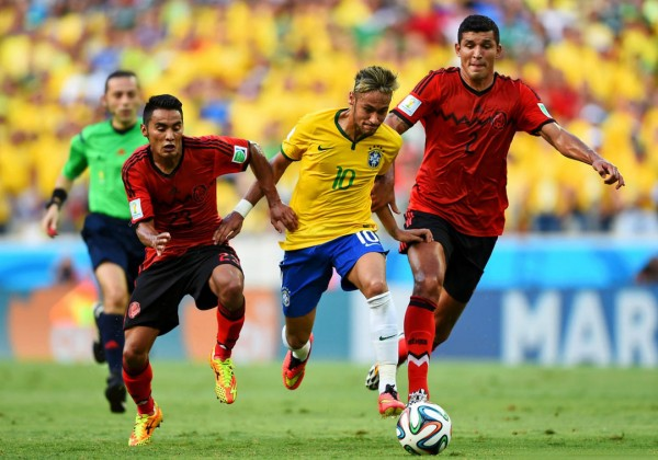 Neymar running away from 2 defenders in the FIFA World Cup 2014