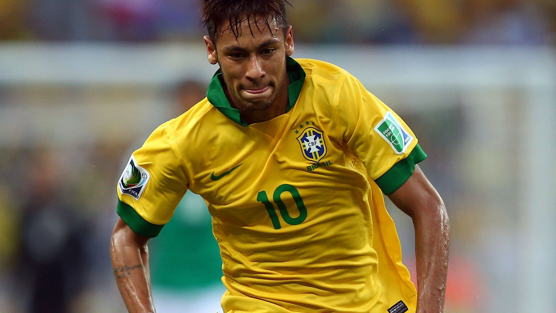 Neymar running for Brazil in the FIFA World Cup 2014