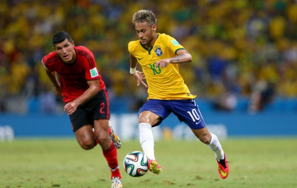 Neymar running with the ball in the FIFA World Cup 2014