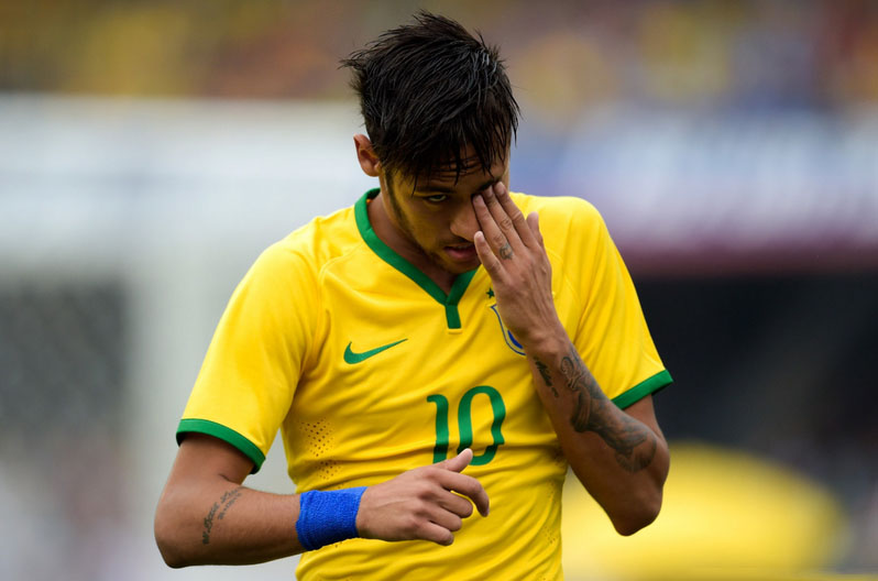 Neymar scratching his eye in Brazil
