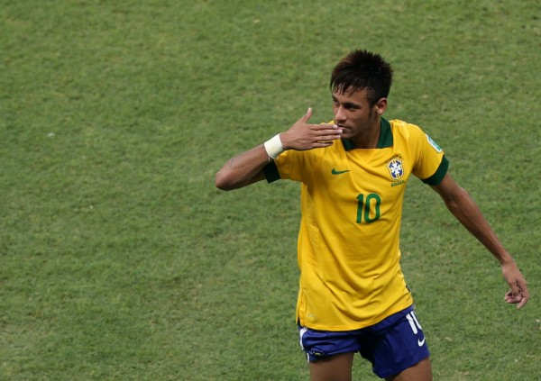 Neymar sending out kisses in the Brazil National Team