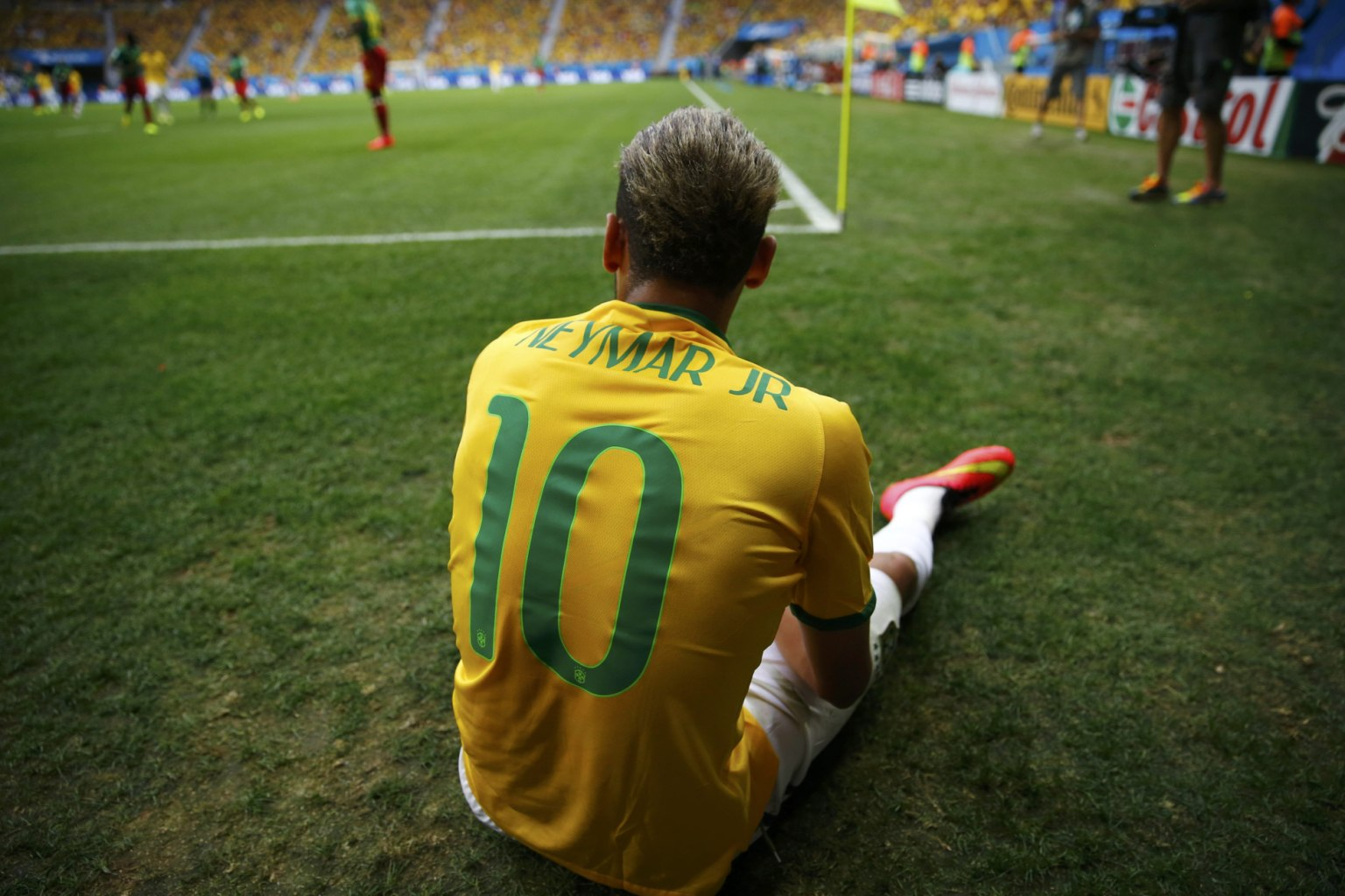 Neymar sitting on the ground, at the FIFA World Cup 2014