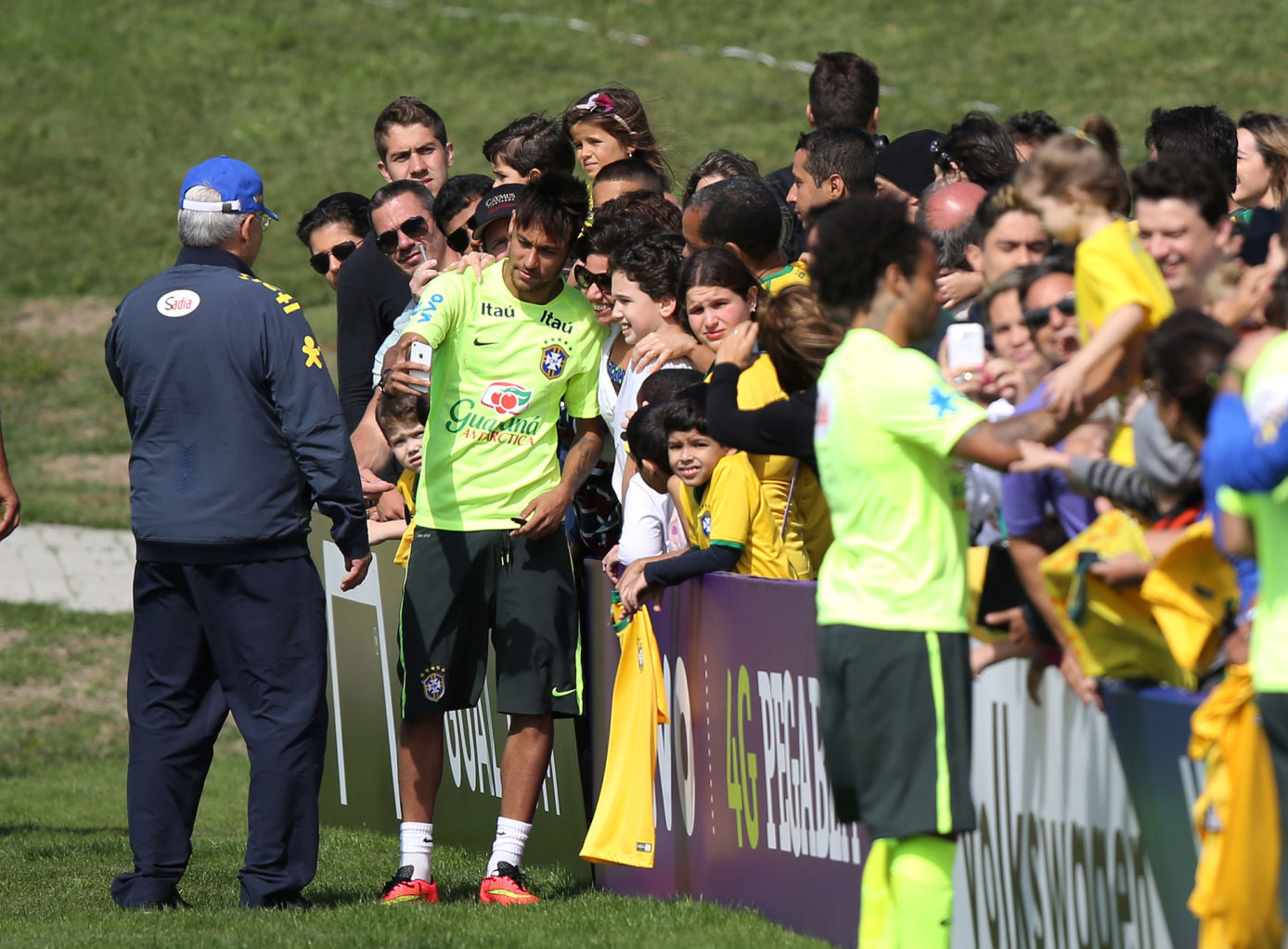 Neymar taking photos with Brazilian fans
