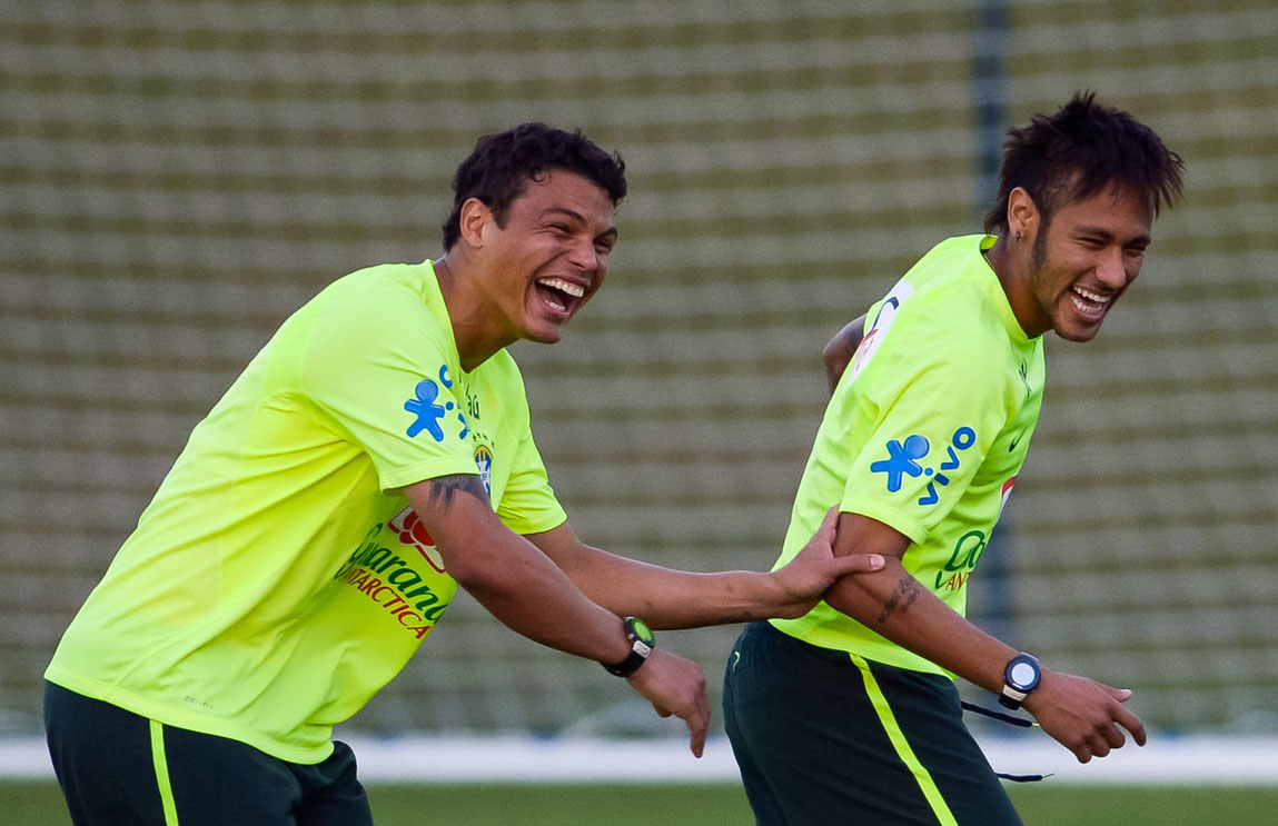Thiago Silva and Neymar playing around and laughing, in Brazilian Team practice