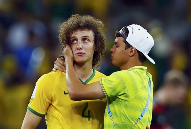 David Luiz crying and Thiago Silva comforting him