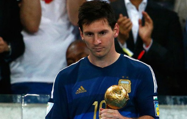 Lionel Messi holding the FIFA World Cup Ballon d'Or 2014