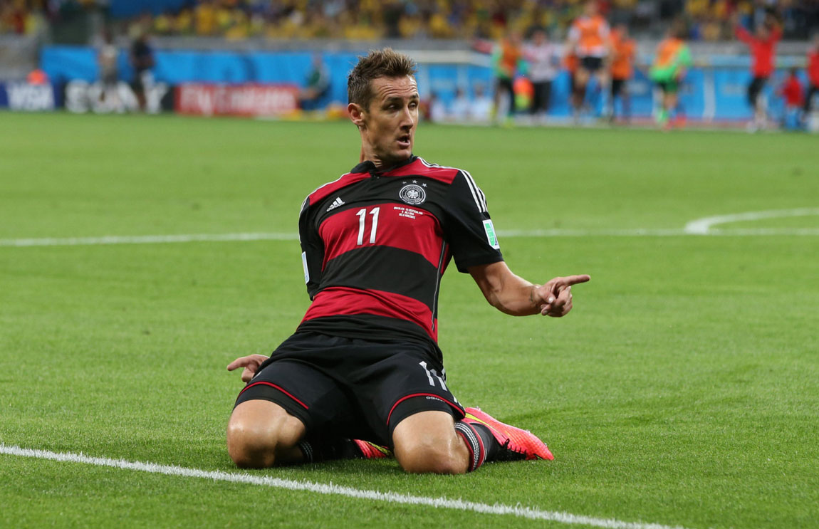 Miroslav Klose sliding knee goal celebration, in Brazil 1-7 Germany