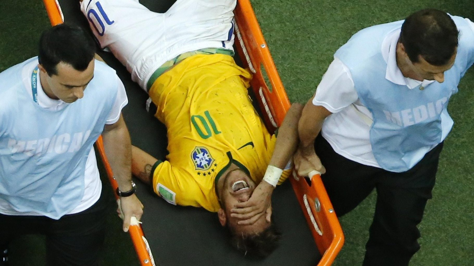 Neymar carried away off the pitch on a stretcher, after his back injury