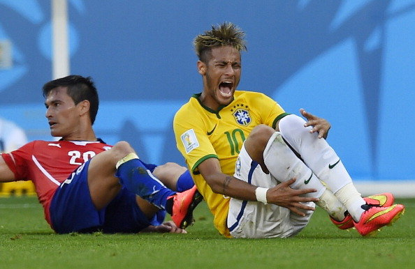 Neymar holding to his ankle, in the FIFA World Cup 2014