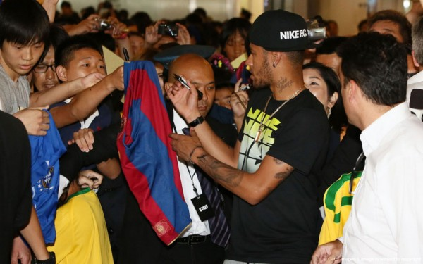 Neymar signing autographs to fans in Tokyo, Japan