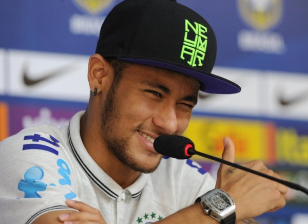 Neymar wearing a hat or cap of his own brand