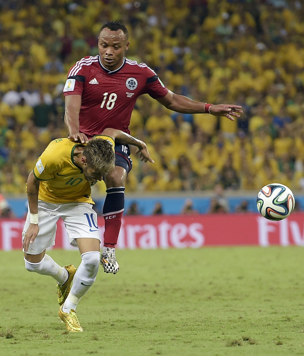 Zuniga injuring Neymar with his knee, in the FIFA World Cup 2014 game between Brazil and Colombia