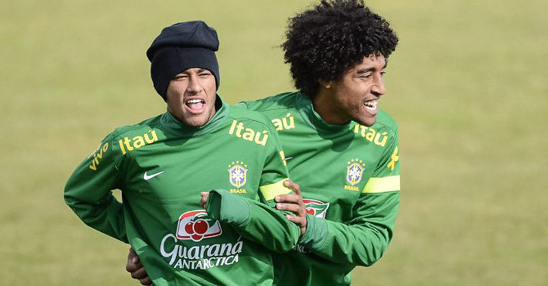 Neymar having fun with Dante in practice