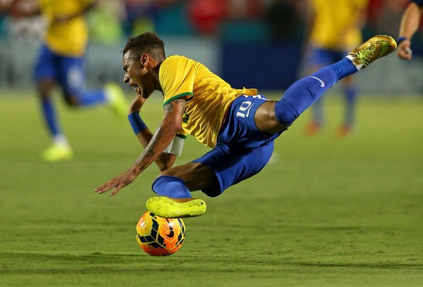 Neymar falling to the ground after being fouled