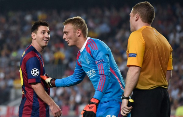 Lionel Messi laughing at the referee