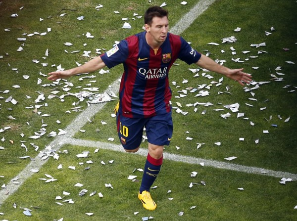 Lionel Messi running on the pitch to celebrate Barcelona goal