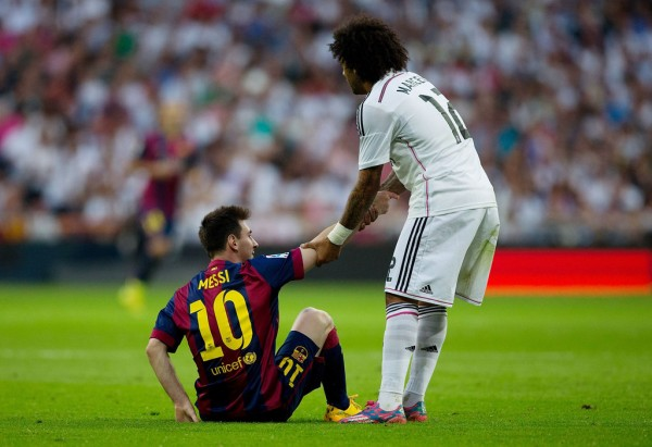 Marcelo helping Messi to stand up, in a La Liga Clasico
